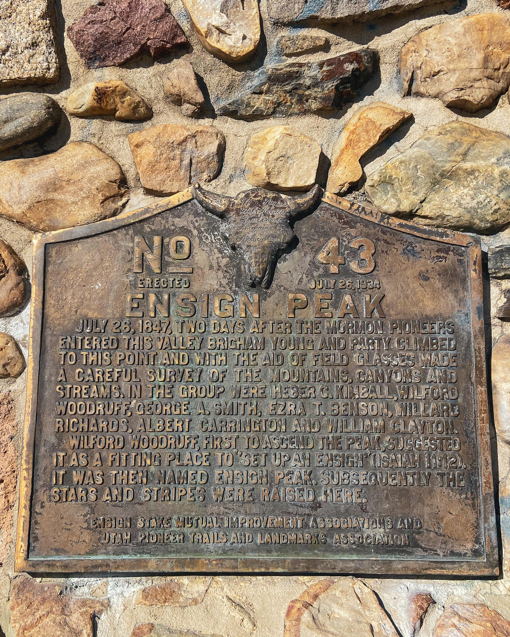 """Hike plaque reads: """"...first to ascend the peak..."""""""