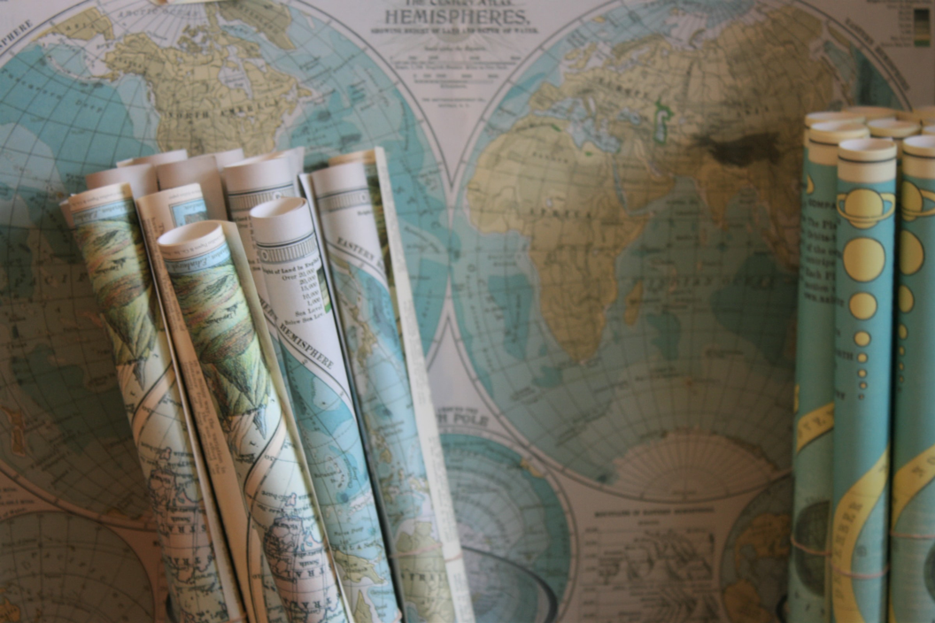 travel maps rolled up as an option for gifts